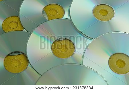 A Full Frame Of Cd's With A Yellow Background
