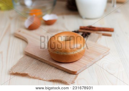 Home Made Donut On Wood Cut Board With Bakery Ingredients On Wooden Table Select Focus Shallow Depth
