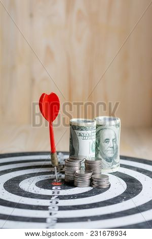 Red Dart Arrow Hit The Center Target Of Dartboard And Money Coin Metaphor Marketing Or Saving Money