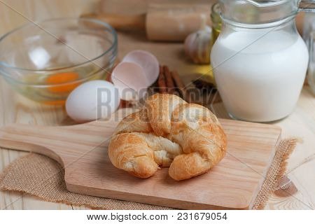 Croissant On Wooden Cut Board On Table Wood And Fabric Select Focus Shallow Depth Of Field