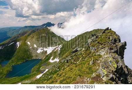 Rocky Cliffs Of Southern Carpathians. Beautiful Mountainous Landscape With Mountain Lake And Low Clo