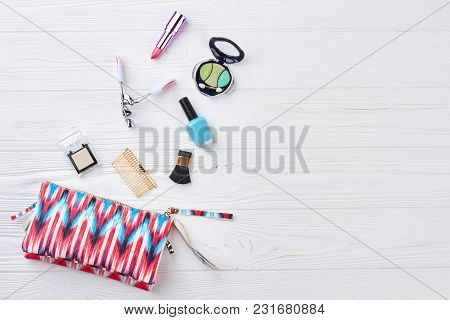 Cosmetic Bag And Makeup Objects. Flat Lay Of Pink Cute Woman Bag Open Out With Cosmetics And Accesso