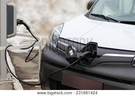 The Car Is On A Charge. Electric Power For Charging An Electric Vehicle. The Electric Vehicle Chargi