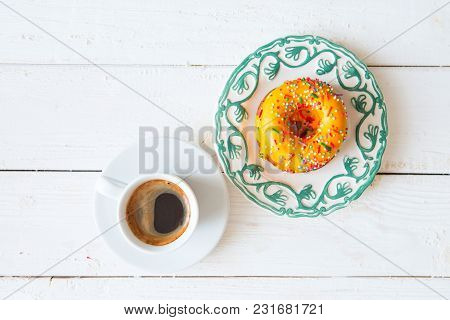 Yellow Donut And Coffee On Wood Background. Top View.