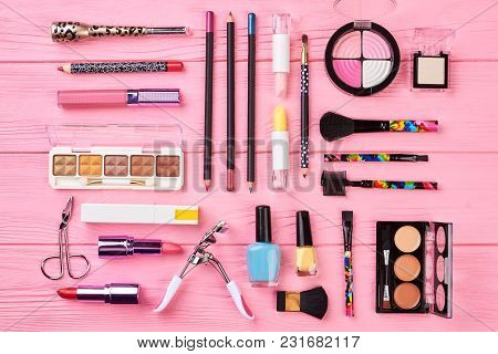 Glamour Cosmetics Set On Pink Background. Make Up Fashion Accessories And Tools On Colorful Wooden B