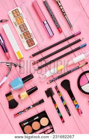 Fashion Cosmetics Set, Top View. Make Up Decorative Products On Pink Wooden Background. Cosmetics Ob