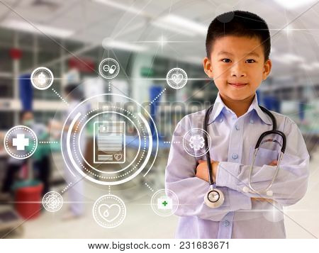 Asian Boy Pretending A Doctor With Blurry Hospital Emergency Room Background  For Medical And Health