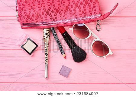 Cosmetics Bag And Fashion Beauty Accessories. Composition With Makeup Bag, Cosmetics And Sunglasses