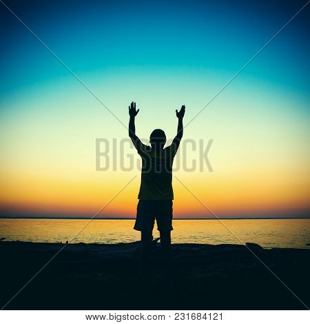 Vignetting Photo Of Man Silhouette Praying At The Sunset