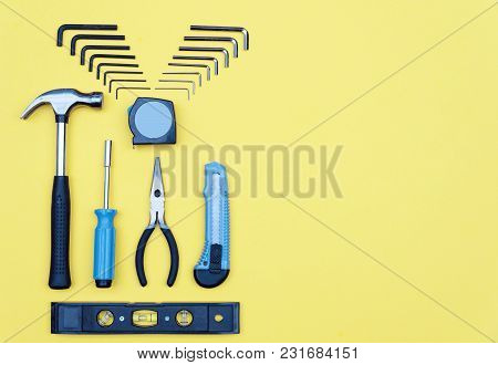 Set Of Tools. Home Improvement Concept On Yellow Background. Copy Space.