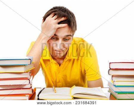 Troubled Student With A Books On The Desk On The White Background