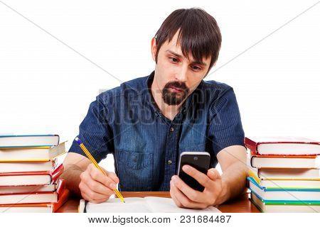 Student Use Smart Phone On The School Desk