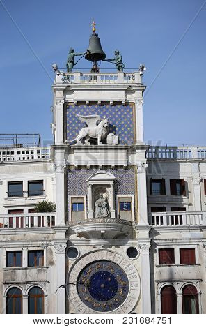 Ancient Bell Tower In Venice Italy Called Campanile Dei Mori In Italian Language With Winged Lion Sy