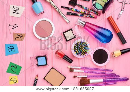 Overhead Beauty Essentials Of Modern Girl. Female Colorful Cosmetics And Tools, Pink Background. Pap