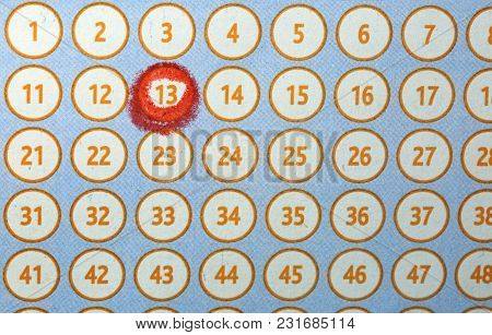 Many Numbers And The Number 13 Circled In Red On A Bingo Card Lottery