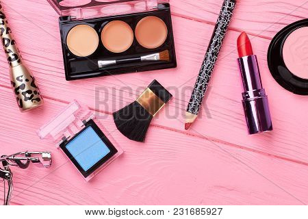 Female Decorative Cosmetics, Wooden Background. Nude Color Lipstick Palette, Eyeshadow, Blusher, Pen