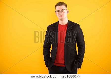 Caucasian Confident Smart Elegant Young Man In Jacket Standing In Office Looking In Camera