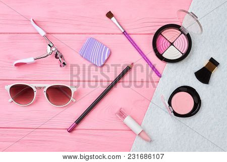 Flat Lay Female Essentials, Color Background. Sunglasses, Lipstick, Eyeshadows, Blusher. Woman Beaut