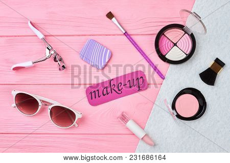 Female Cosmetics And Accessories. Eyeshadows, Brush, Blusher, Lipstick, Sunglasses On Color Backgrou