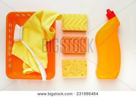 Set Of Yellow House Cleaning Products And Supplies On White Isolated Background, Top View. Spring Cl
