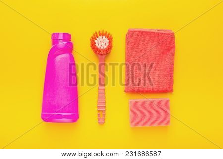 Set Of Pink House Cleaning Products And Supplies On Yellow Isolated Background, Top View. Spring Cle