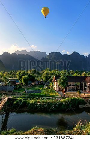 Hot Air Balloon Flying In Vang Vieng, Vientiane Province, Laos. Vang Vieng Is A Popular Destination