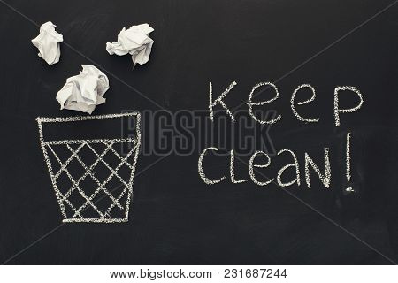 Keep Clean Written With Chalk On Blackboard Next To Trash Bin And Crumpled Papers, Top View, Copy Sp