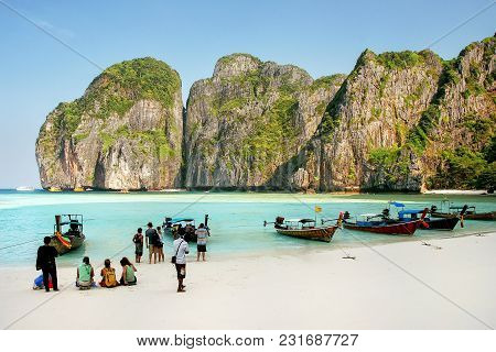 Tourists And Longtail Boats At Maya Bay On Phi Phi Leh Island, Krabi Province, Thailand. It Is Part