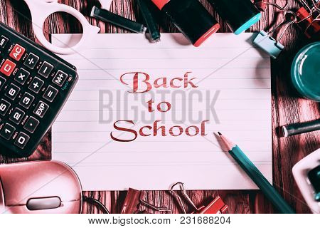 Back To School Background With School Supplies On Wooden Background. Greeting Card