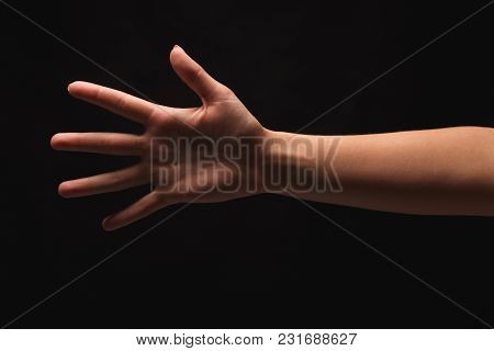 Female Hand Showing Open Palm, Number Five Isolated At Black Background. Counting, Gesturing, Enumer