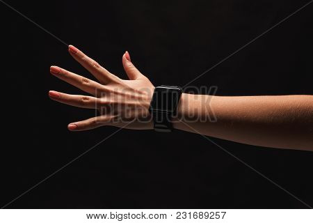 Female Hand With Smart Watches. Hand Gestures - Woman Showing Open Palm, Isolated On Black Backgroun