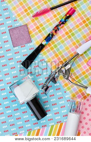 Female Cosmetics And Tools, Top View. Feminine Beauty Items On Colorful Background. Woman Makeup Pro