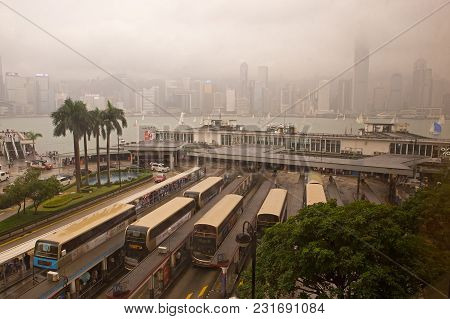 Kowloon, Hong Kong - Nov 12, 2017: Coaches Wait For Passengers At The Bus Terminal By Victoria Harbo