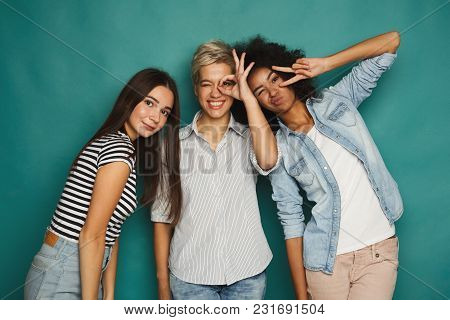 Happy Female Friends Having Fun At Blue Background. Three Young Women Posing And Laughing, Slumber P