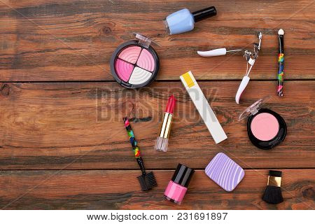 Make Up Objects On Wooden Background. Fashion Design Cosmetics Items On Brown Table, Copy Space.