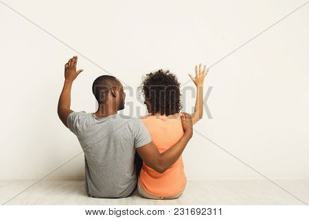 African-american Family Couple Looking Up, Sitting On Floor In New Apartment, Dreaming About Future,