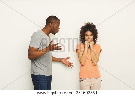 Black Couple Arguing. Angry African-american Men Shouting At His Girlfriend At White Studio Backgrou