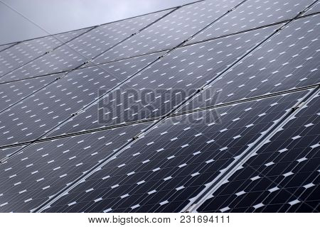 Close Up View Of Solar Panels And Cloudy Sky