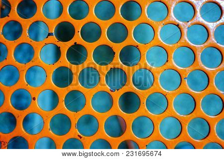 Orange Color Painted On Rusty Metal Tubes Of A Steel Fence  For Background Texture
