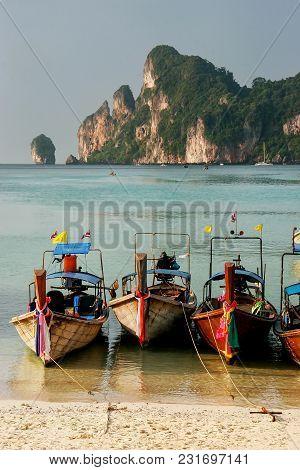 Longtail Boats Anchored At Ao Loh Dalum Beach On Phi Phi Don Island, Krabi Province, Thailand. Koh P
