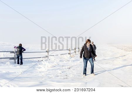 Horizontal Image Of Three Caucasian Women  Enjoying Their Time Together Walking  In A  Frosty Snowy
