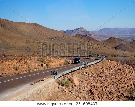 Black Car On The Road At Mountainside Landscapes At High Atlas Mountains Range Near Oulad Village In