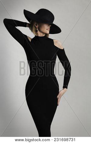 Fashion Model Long Dress, Wide Brimmed Hat, Elegant Lady Beauty Portrait, Woman Posing On White Stud