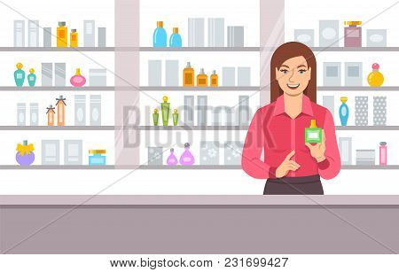 Perfumer Girl Near Shelves With Perfumes. Young Woman Seller Offering Bottle With New Aroma At The C