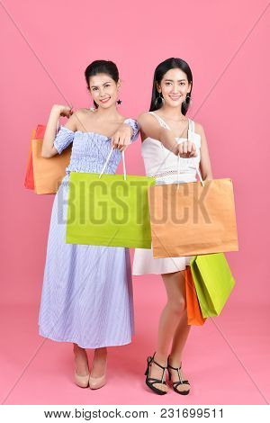 Shopping Concepts. Beautiful Girls Shopping In Department Stores. Beautiful Girl Happy To Shop. Asia