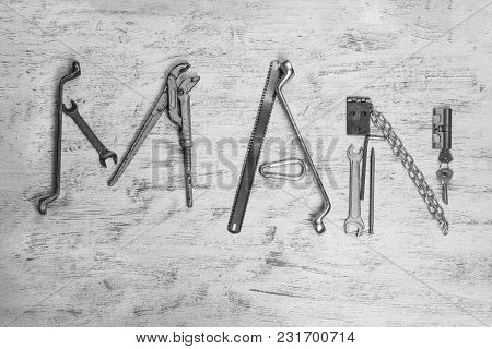 Text Man Is Written By Work Tools. The Word Man Is Made Up Of A Work Tools.