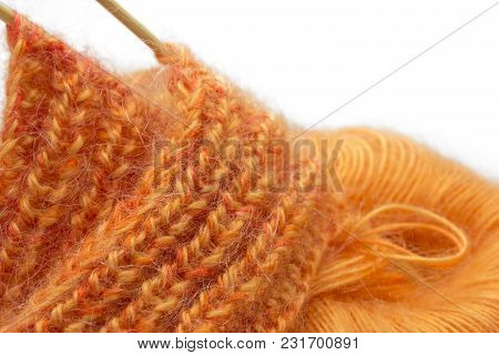 Knitting Orange Colorful Melange Mohair Wool Ball And Knitting Needles Isolated On White Background.