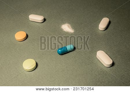 Pills And Medications On The Photo Close Up. Can Be Used In Publications On The Investigation In The