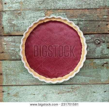 Healthy Scandinavian Dessert. Open Lingonbery Pie On Shabby Blue Wooden Background Top View Copyspac