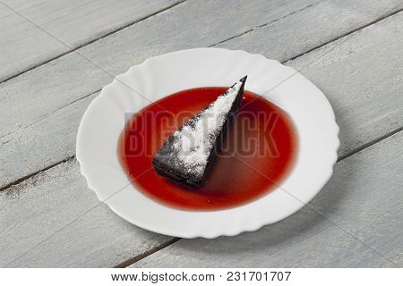 Chocolate Pie With Sugar Powder And Raspberry Jam